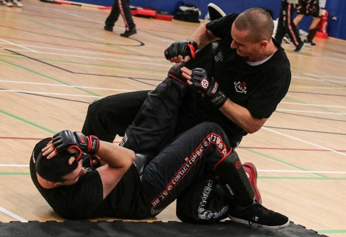 Learn how to defend against chokes on the ground online